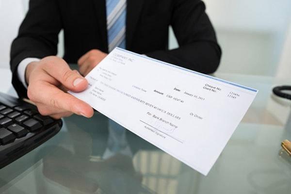 Requisitos para préstamos en cooperativas firmando cheques